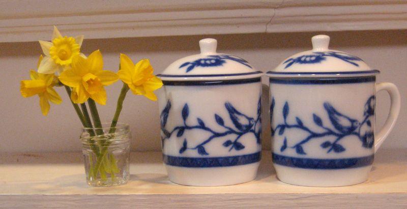 Minis on shelf with mugs